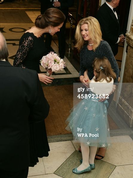 The Duke And Duchess Of Cambridge Attend The Royal Variety Performance Credit: WPA Pool / Pool Caption:LONDON, ENGLAND - NOVEMBER 13: Catherine, Duchess of Cambridge meets Charlotte Tomlinson, aged 6, and her mother Cathryn at The Royal Variety Performance at the London Palladium on November 13, 2014 in London, England.