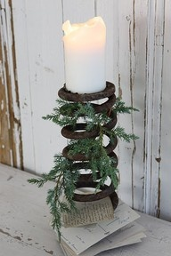 Rusty old spring candle holder ..... make it Christmas by adding greenery.