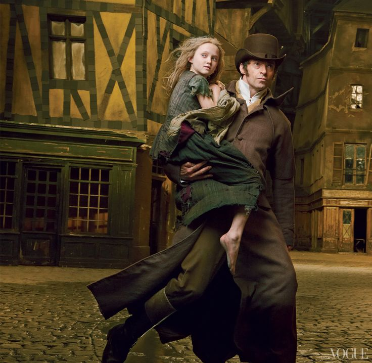 Les Misérables: Hugh Jackman as Jean Valjean rescuing the young Cozette played by Isabelle Allen. Shot by Annie Leibovitz for Vogue US.