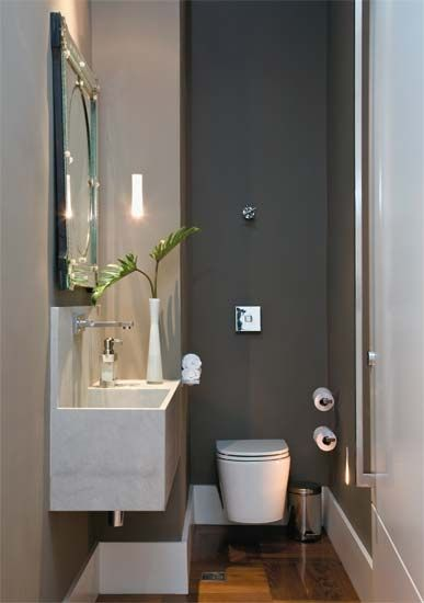 Love the contrast in colors. Too dark for a small bathroom probably.