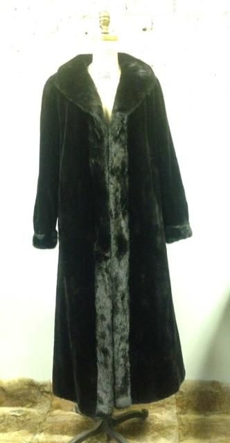 Black Mink Coat with Reversible Water Repellent Silk Black sheared mink coat with long haired mink tuxedo front and cuffs.  Reversible to water repellant silk.  Options include sheared mink hood with reversible sink; detachable.  (Sold separately)  Check out our coats here: http://www.shopsydneygittermanfurs.ca/products/black-mink-coat-with-reversible-water-repellent-silk