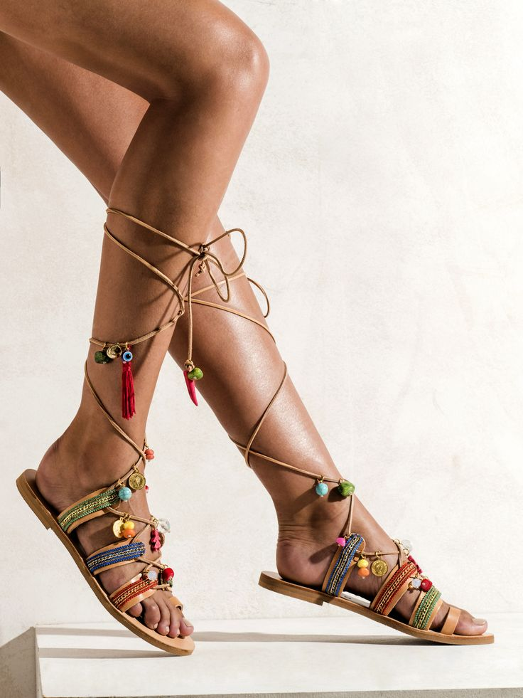 Handmade Greek sandals decorated with semiprecious stones like turquoise stones and red corals, Italian crystals and colorful cotton straps.   http://www.elinalinardaki.com/shoes/sandals/all-time-classics/sandal-frida/