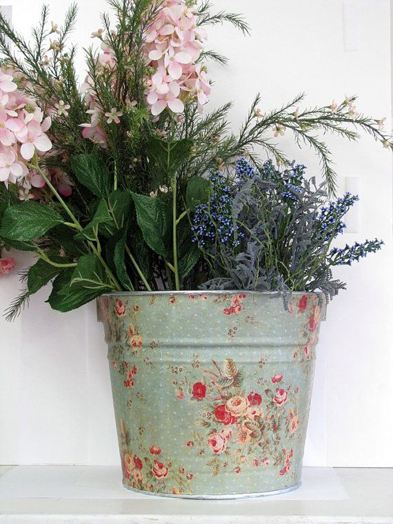 Plain metal plant pots give a completely different look with some light decoupage.