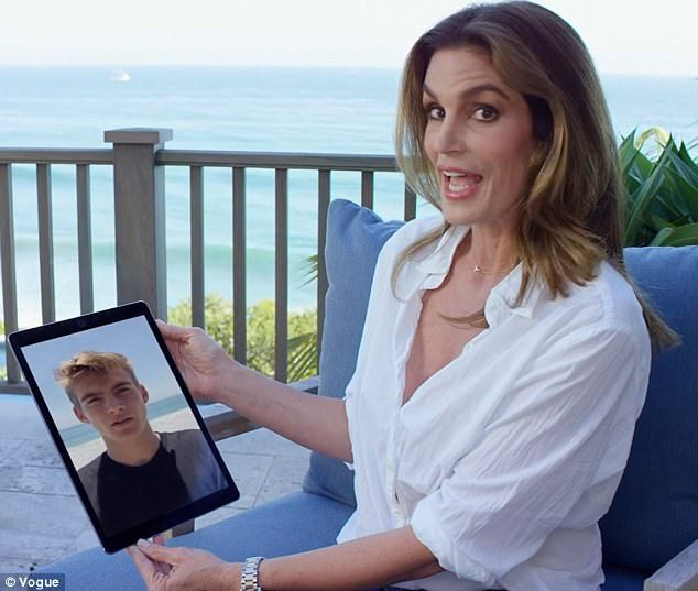 Questions: Cindy's 18-year-old son Presley Walker Gerber joined the interview via video call (pictured) to ask his mother about her favorite part of motherhood