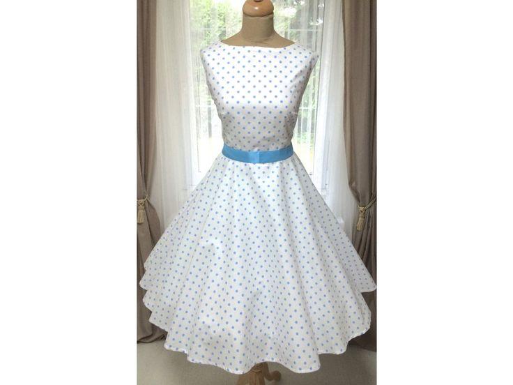 SUSAN retro šaty s puntíkem. lodičkový výstřih knoflíčky na zadní straně kolová sukně pásek s ozdobnou sponou délka sukně 60 cm, zip na boku skladem velikost 40