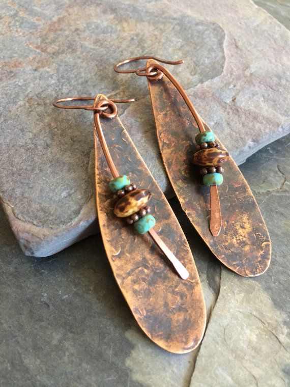 Hang length-3 From my hand forged copper ear wires hang hammered and antiqued copper drops with hammered copper wire and Czech glass bead dangles.
