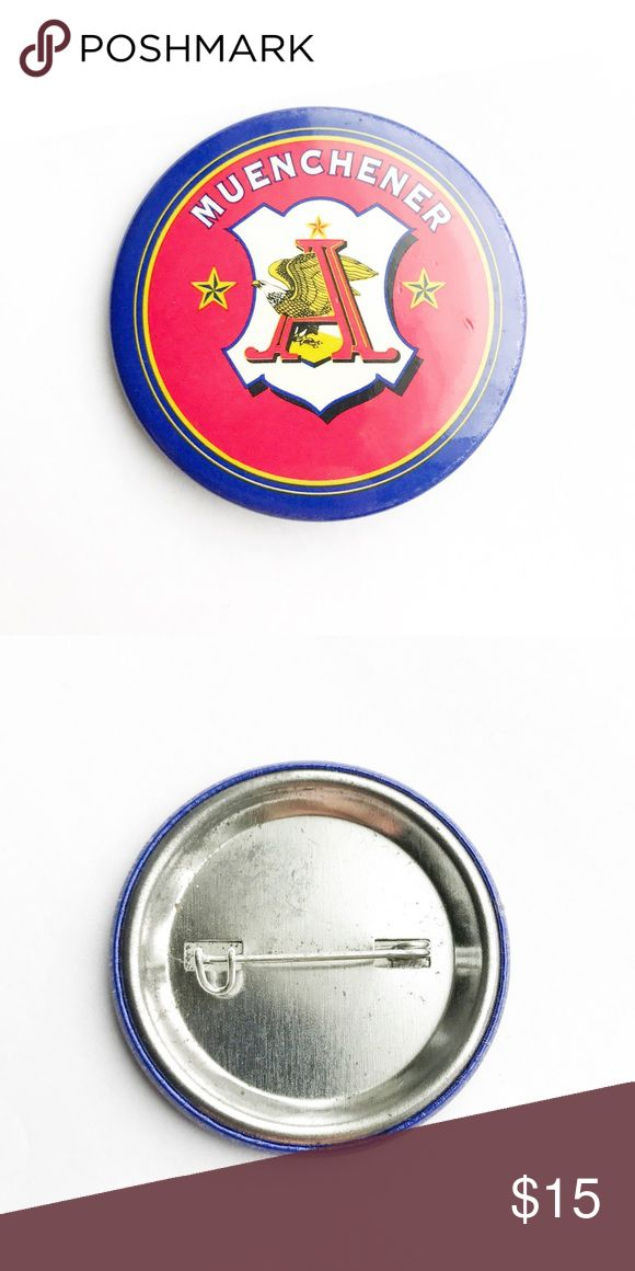 """Vintage Muenchener Beer Pin Vintage Muenchener Beer Pin  • true vintage • 1  3/4"""" • colors: red, white, blue, black, yellow • tags: Budweiser, anheuser busch, eagle, pilsner beer, alcohol, pinback, button, america, freedom, drink, can, bottle, breweriana, americana, logo, awesome, hat, lapel, vest, jacket, bag, backpack, accessory, accessories  • all of the pins I sell are vintage & may contain nicks, imperfections, or oxidation Vintage Accessories"""