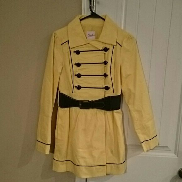 Canary yellow lightweight jacket size small This is a pale yellow spring trench style belted coat. It has black detailing and is by Candies. Although I purchased and never wore the jacket there is some discoloration on the right arm as well as a small spot on the front left corner of the bottom of the coat. I have not attempted to wash the item however it may come out with washing. Due to these discolorations I am listing items very low. It's very cute and perfect for the spring time…