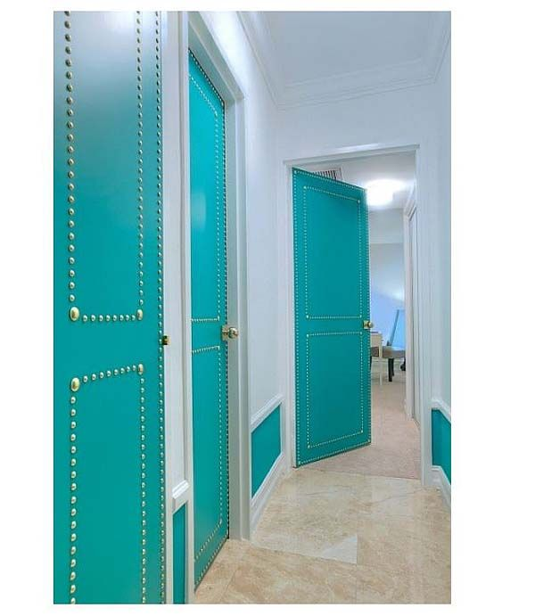 Beautiful blue doors with nail head trim. Love the bigger nails at the corners.