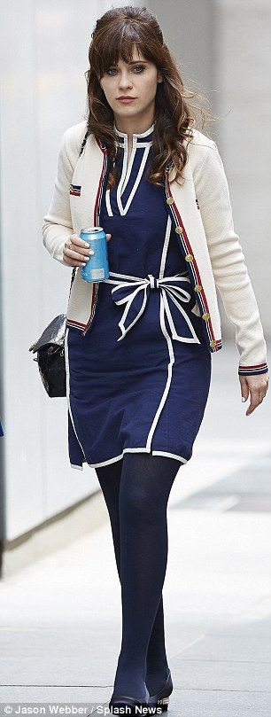 Rock on Tommy: Zooey's final ensemble was one of her blue and white dresses which she teamed with tights and a beige cardigan