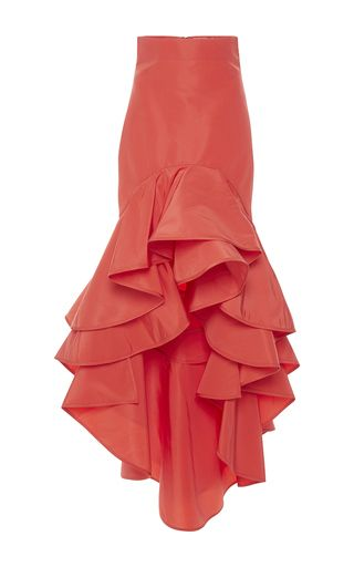 This high waisted **Johanna Ortiz** skirt is rendered in silk faille and features a fluted shape with a tiered ruffle, high-low hem.
