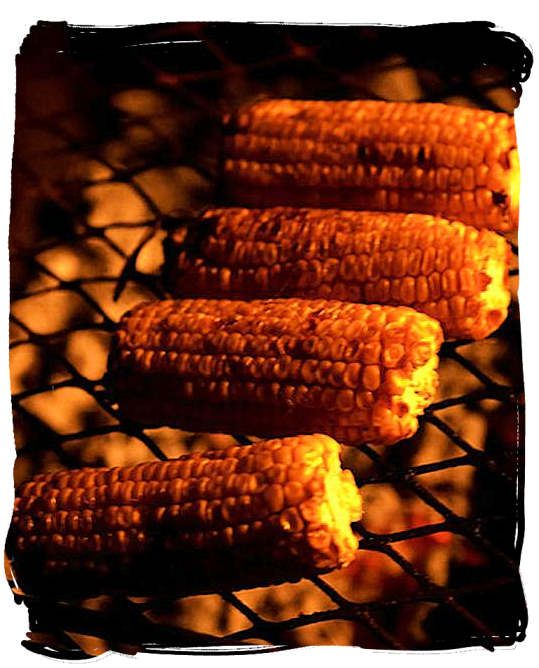 Mielies (maize cobs) grilled directly on the braai over the coals are a delicacy not to be missed