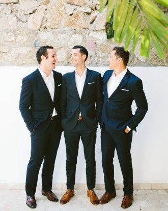 "The groomsmen (aka the ""best men"") sported Hugo Boss suits and white linen pocket squares, a gift from the couple."