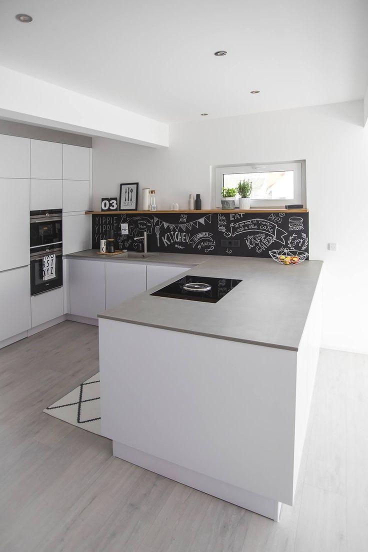 bora kundenkueche rainer schreier-Modern Kitchen With Black Cabinets