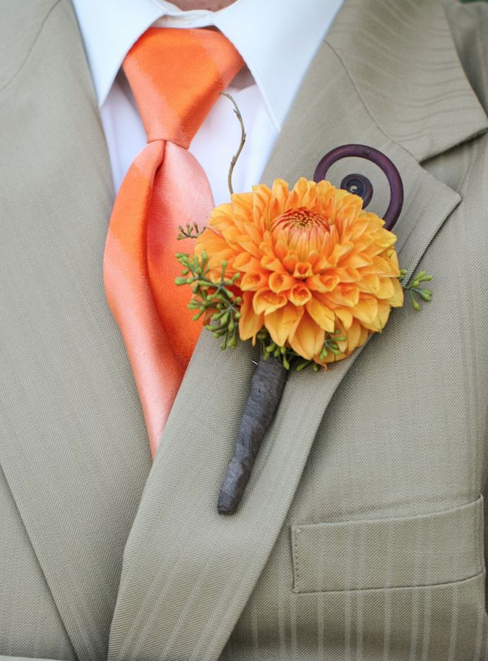 love a pop of orange for the groom and his men #boutonniere #groom #groomsmen #orange #wedding http://theflowerhouse.com/