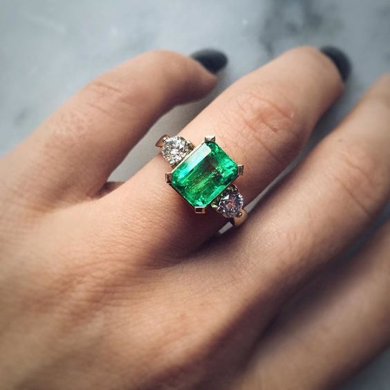 Wow! Check out this engagement ring! The color is incredible - we're in love! Click for more wedding color inspiration!