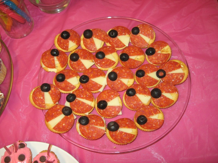 ritz crackers, mozzarella cheese, pepperonis and black olive half