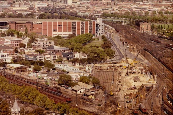 Construction of the Melbourne Underground Rail Loop's Jolimont access tunnel, as viewed from the Reserve Bank building on 6 October 1972. Note the old Melbourne Cricket Ground in the background.