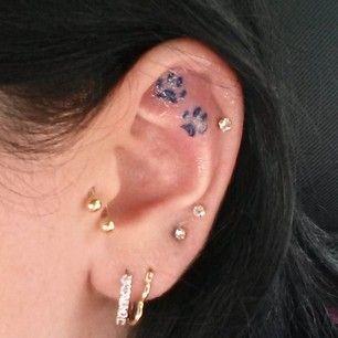 Foot Print Inner Ear Tattoo
