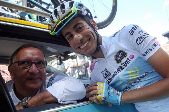 Giro d'Italia 2014 - Stage 21 - Fabio Aru celebrates with team manager Giuseppe Martinelli