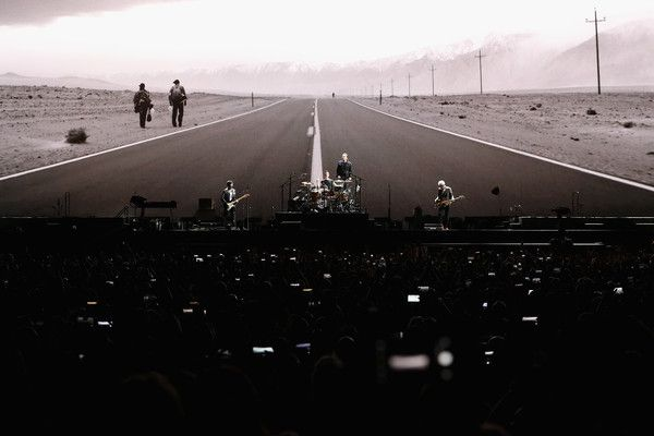 Bono Larry Mullen Jr Photos - The Edge, Larry Mullen Jr, Bono and Adam Clayton of U2 perform during The Joshua Tree Tour 2017 at University of Phoenix Stadium on September 19, 2017 in Glendale, Arizona. - U2 Performs at University of Phoenix Stadium