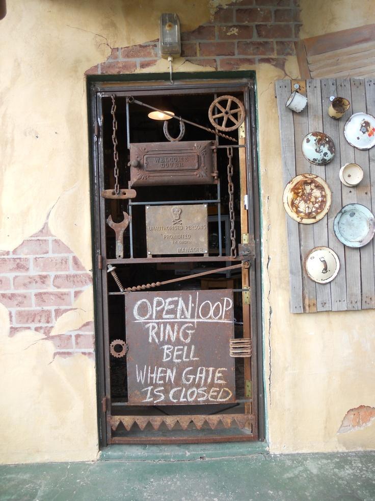 Unusual iron gate at a shop in De Rust, South Africa