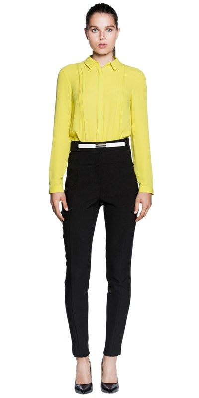 Made from soft georgette fabric, this long sleeve shirt features a small collar, concealed button down placket and soft pleat detail. Finished with a shaped hem and button cuffs.