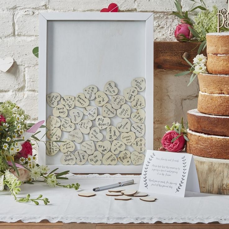 Our Drop Top Wooden Guest Book Frame is the perfect piece for your special day. Your guests can write their names on the heart pieces and drop it in the frame, leaving a beautiful collage of memories for your home later on! Shop online now • www.whitelacepartyware.com.au