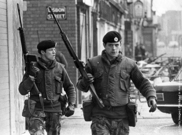 1972:  Armed British soldiers on patrol in Lisbon Street, Belfast, during the Official IRA's unconditional ceasefire