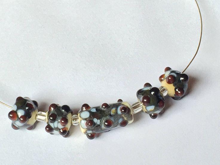 Cream/frit lampwork beads by celestialbeadings on Etsy https://www.etsy.com/ca/listing/529749545/creamfrit-lampwork-beads