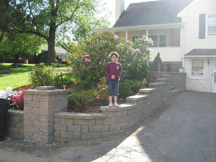 Love this retaining wall idea for my driveway looking to for Sloped driveway options