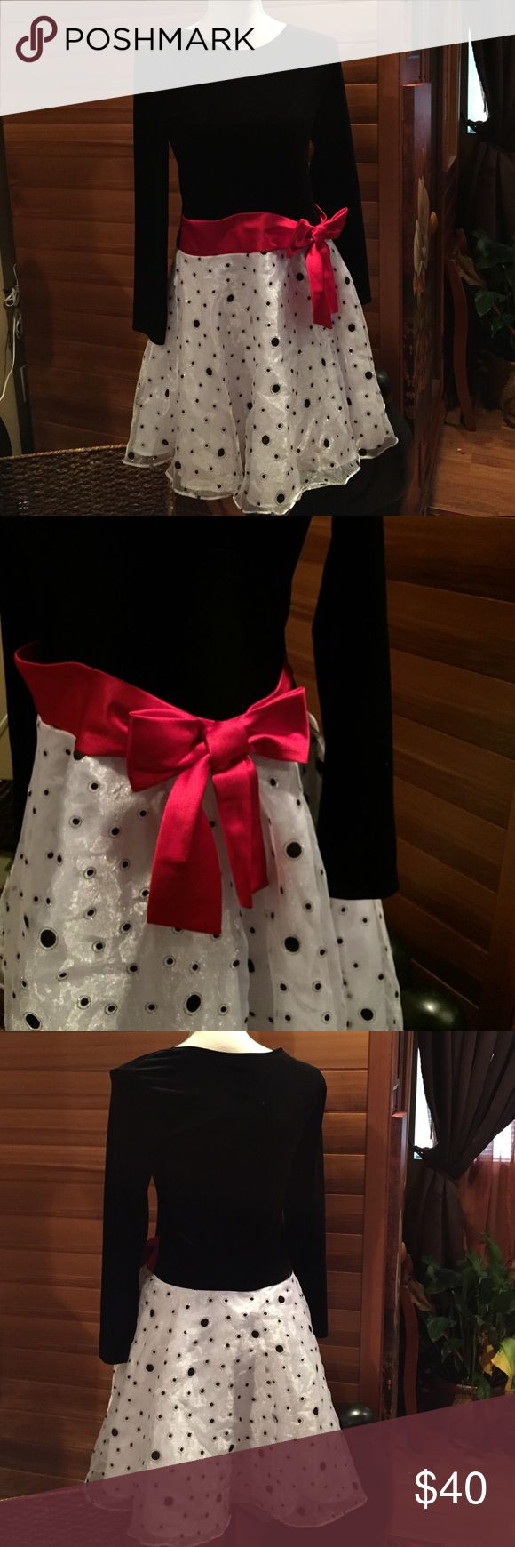 Like New Holiday/Formal Dress Like New Dress with velvety black top portion, bright red Bow at he waist and sheer white with black polka dot skirt (metallic circled). Wore once.  Beautiful Dress!! Bonnie Jean Dresses Formal