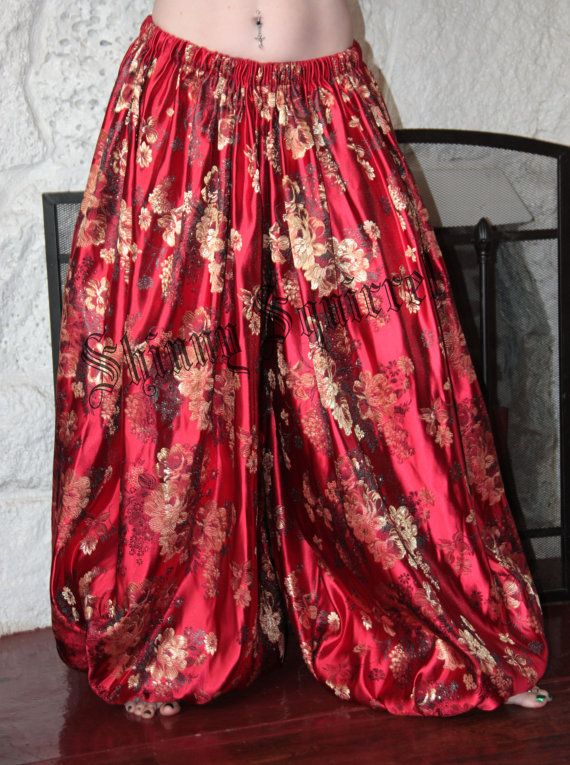 These billowy harem pants made out of 4 yards of a medium weight jacquard brocade. Each leg measures 72 wide! One size will fit most. Elastic