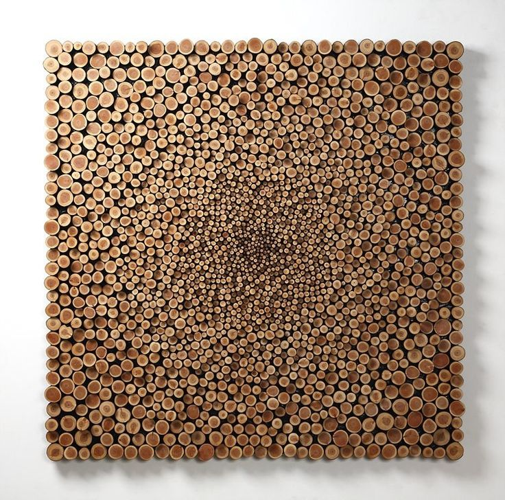 Decorative log tiles from www.thelogbasket.co.uk could create a similar display in your home or workplace.