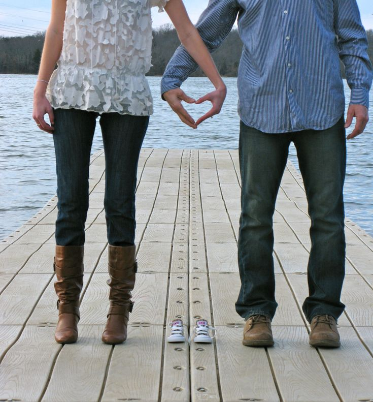 Baby announcements but you could make this an engagement just replace the shoes with a wring in the middle of their hands.