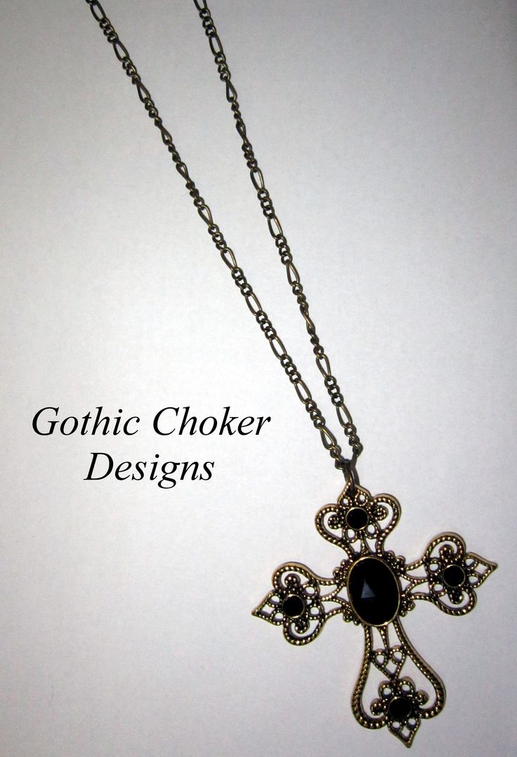 Bronze cross and black stones necklace. R100 approx $10.  Purchase here: https://hellopretty.co.za/gothic-choker-designs/bronze-cross-necklace