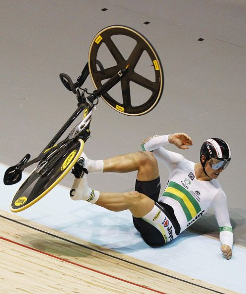 Australia's Matthew Glaetzer falls from his bike during his qualifying heat at the men's Keirin at the 2012 UCI Track Cycling World Championships in Melbourne