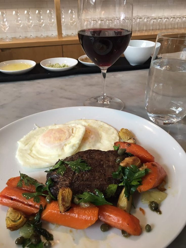 Photo of Farmshop - Santa Monica, CA, United States. Brandt Farm Flat Iron Steak- more char would be nice, but Excellent! Fricassee carrots, shaved chokes-Outstanding! w/ RYME 2014 Pinot Noir