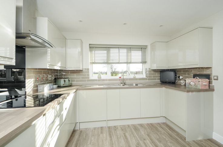 Woodlands, Launton - Hollybrook kitchen Glendevon French Grey with integrated handles from Howdens Joinery Tiling from Bicester Tiles and Fireplaces Flooring is luxury vinyl strips from Expona, Polyfloor