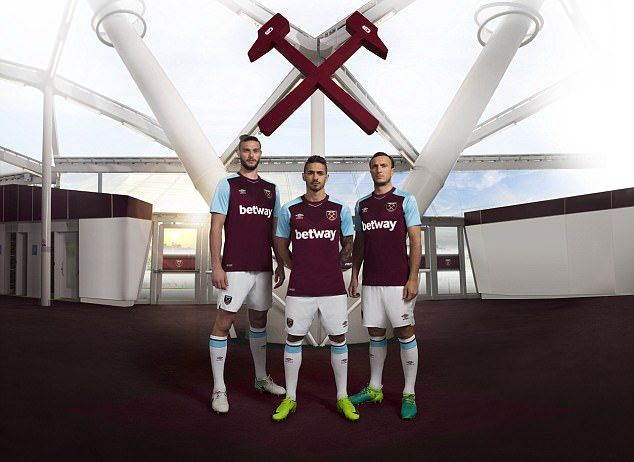 West Ham stars Andy Carroll, Manuel Lanzini and Mark Noble pose in the new strip
