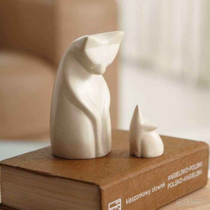 Soapstone Cat And Mouse A moment of confrontation or reconciliation? Either way, this petite cat and mouse set is adorable. Carved from natural soapstone to a smooth finish. cat: 4 in. h; mouse: 1 1/2 in. h