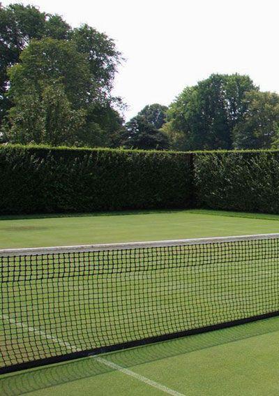 grass tennis court in the backyard