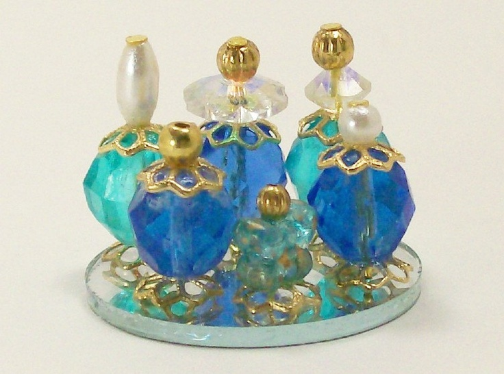 Dollhouse Miniature Perfume Bottle Collection Oceans Blue Azure Teal One Inch Scale. $19.00, via Etsy.