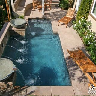 Swimming Pool Design For Small Spaces designs small inground pools Small Pools Love The Fountains And The White Flowers Along The Sides