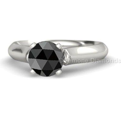 This ring center stone in rose cut solitaire engagement ring .And this Quality of the stone is AAA quality. The color of the Natural Black diamond is Jet Black color.