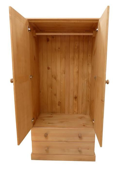 Solid pine tongue and groove back on a beautiful wardrobe with 2 drawers.