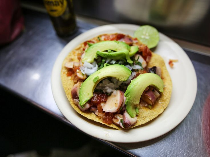 K-Guamo, a street stand within walking distance of Mercado San Juan, serves pitch perfect seafood tostadas. Get one. Get many.