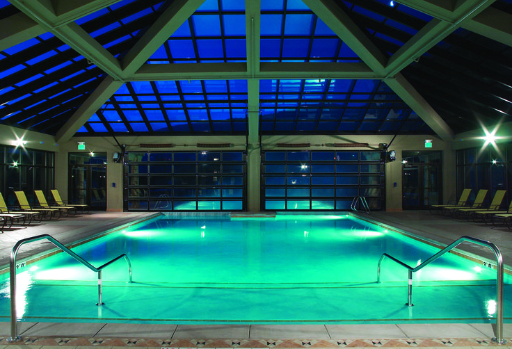 Indoor-outdoor pool at night at the Westgate Park City ...
