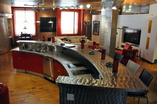 That is the hottest kitchen ever. Refurbished firehouse.