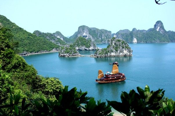 #1. Bai Tu Long Bay  They say Halong Bay in Vietnam is stunning. Wait till you see Bai Tu Long, its eastern neighbor; every bit as beautiful as Halong Bay or maybe more. Bai Lu Tong Bay has what Halong doesn't have – less people. The reason, of course, is its accessibility, which is only by a ferry or a 'junk-boat' cruise. You should visit this rare gem if you are fond of swimming without encountering carelessly strewn garbage in the sea.